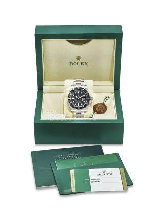 ROLEX. AN ATTRACTIVE AND FINE STAINLESS STEEL AUTOMATIC WRISTWATCH WITH BRACELET, SWEEP CENTER SECOND, DATE, ORIGINAL WARRANTY AND BOX
