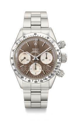 Rolex. A very fine and rare stainless steel chronograph wristwatch with tropical dial and bracelet