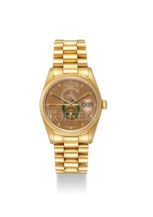 """ROLEX. A FINE 18K GOLD AUTOMATIC WRISTWATCH WITH SWEEP CENTRE SECONDS, DAY, DATE AND BRACELET, """"UAE ARMED FORCES EAGLE"""" COAT OF ARMS"""