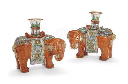 A PAIR OF 'CANTON FAMILLE ROSE' ELEPHANT CANDLEHOLDERS