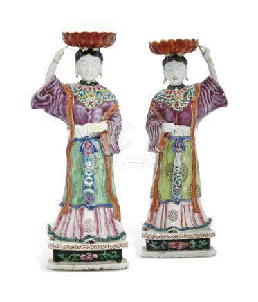 A RARE PAIR OF LADY CANDLEHOLDERS