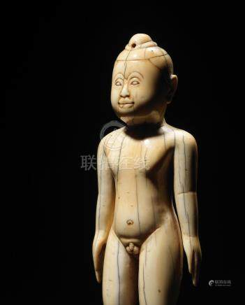AN IVORY FIGURE OF A BOY Myanmar or Thailand, 18-19th century