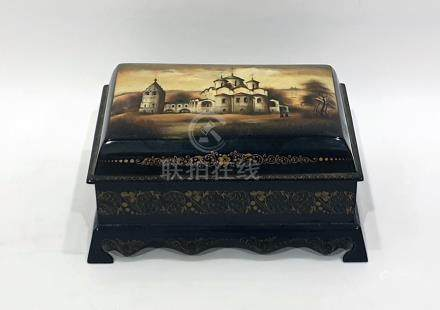 Russian Fedoskino lacquer decorated box featuring building with figures conversing outside,