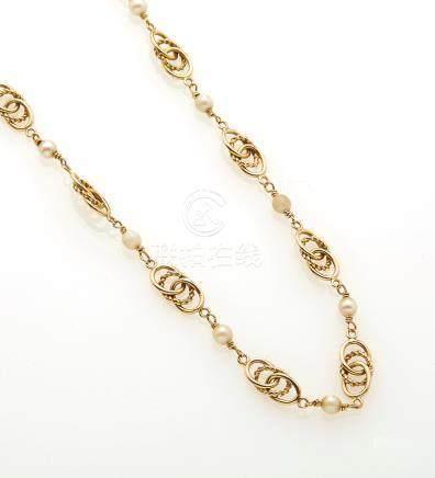 Collier en or jaune 18K (750/°°) maille fantaisie, entrecoupées de perles. (mau
