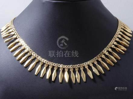 Collier en or 750 millièmes composé d'une chute de pampilles en or estampé. Il