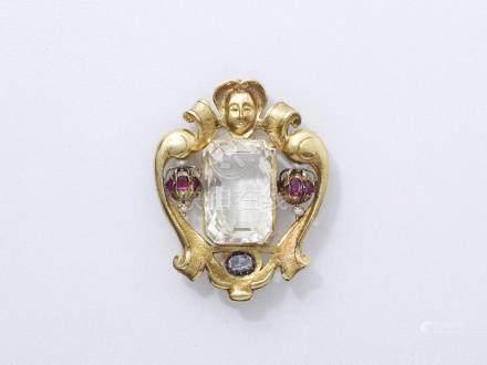 Broche pendentif en or 750 millièmes finement ciselé surmontée d'un visage de f
