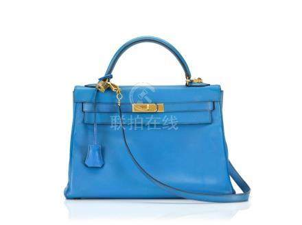 KELLY 32 RETOURNE BLUE FRANCE COLOUR IN COURCHEVEL LEATHER WITH GOLD HARDWARE. HERMÈS, 1992