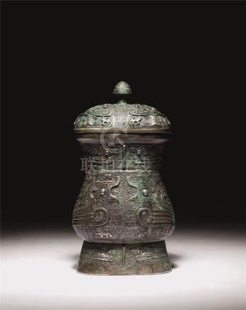商晚期 青铜凤鸟纹觯