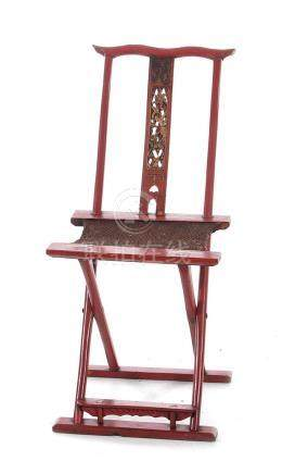 Chinese carved red-lacquer folding elder's chair