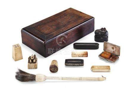 NINE SEALS AND A BRUSH IN A BOX