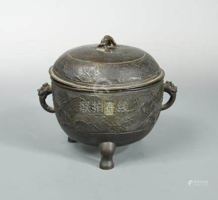 A bronze ritual tripod food vessel Ding and cover, Yuan or early Ming dynasty, raised on three