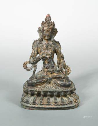 A Sino-Tibetan bronze figure of Vajrasattva, 19th or 20th century, finely cast seated in