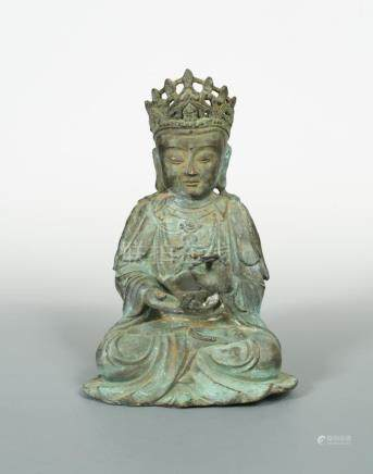 A bronze figure of a bodhisattva, possibly Ming dynasty, heavily cast and portrayed seated in