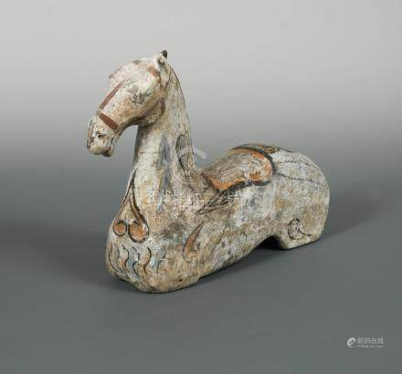 A painted pottery model of a horse, Han dynasty, the body boldly modelled with perforations to