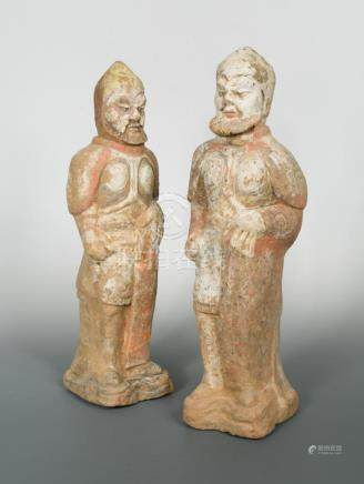 A pair of large Northern Wei dynasty bearded and armoured warriors, with traces of several