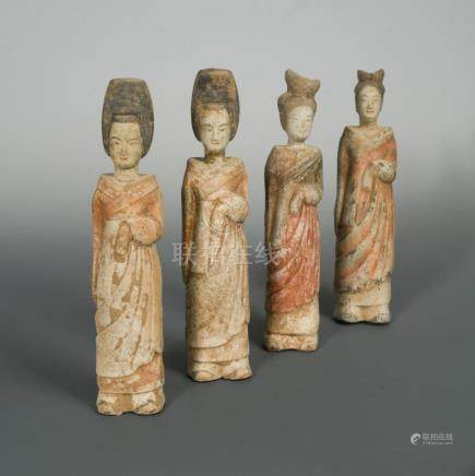 A group of four terracotta figures of ladies, comprising a pair of Northern Wei dynasty court ladies
