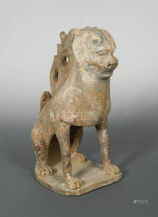A pottery earth spirit, Tang dynasty, modelled as seated mythical beast, in cream with some