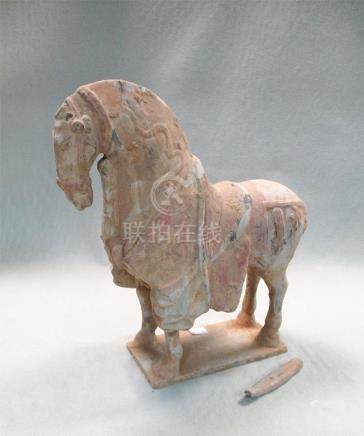 A pottery model horse, Sui or early Tang dynasty, the head slightly lowered, on a rectangular base