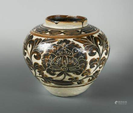 A Jin dynasty Cizhou Sgraffiato jar, the decoration created by carving through the layer of brown