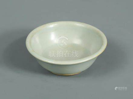 A Song dynasty Longquan celadon brush washer, finely moulded with a flared rim to the body, raised