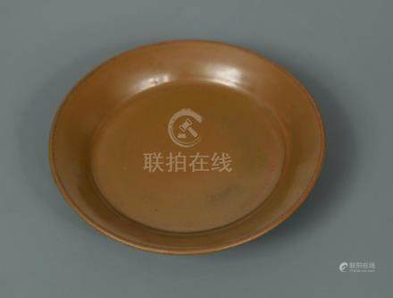 A rare Yaozhou kiln persimmon-glazed dish, Northern Song or Jin dynasty, the shallow dish potted