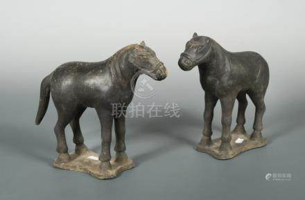 A pair of Yuan or early Ming dynasty horses, in black terracotta, (one with broken tail), 20cm