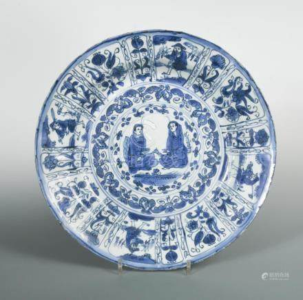 A rare Ming dynasty Kraak dish depicting two Persian figures, c.1600-1644, with cobalt underglaze