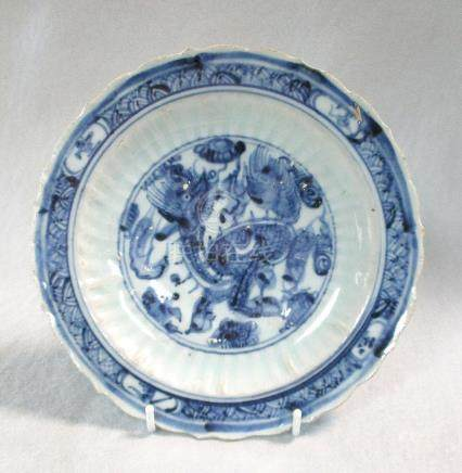 A 15th century Ming dynasty barbed dish, painted with a Qilin roundel, the reverse cavetto
