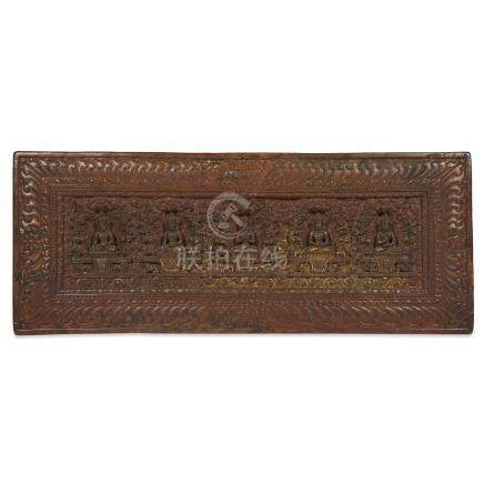 A TIBETAN CARVED WOOD AND PARCEL-GILT SUTRA COVER