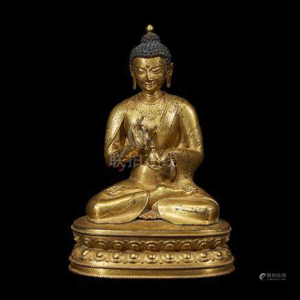 A FINELY CAST AND ENGRAVED SINO-TIBETAN GILT COPPER ALLOY FIGURE OF A SEATED BUDDHA