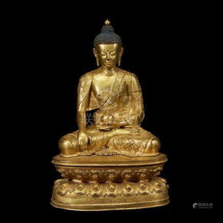 A FINELY CAST AND ENGRAVED TIBETAN GILT COPPER ALLOY FIGURE OF A SEATED BUDDHA
