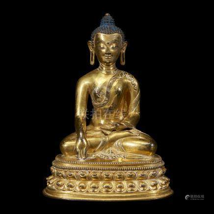 A TIBETAN GILT COPPER ALLOY FIGURE OF SHAKYAMUNI BUDDHA