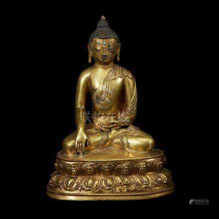 A TIBETAN GILT COPPER ALLOY FIGURE OF SHAKYAMUNI BUDDHA SEATED