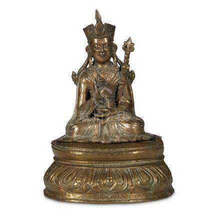 A TIBETAN CAST AND REPOUSSÉ BRASS FIGURE OF PADMASAMBHAVA