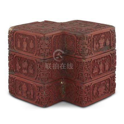 A CHINESE CARVED CINNABAR LACQUER 'DOUBLE LOZENGE' THREE-TIER BOX