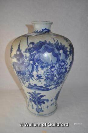 A Chinese blue and white baluster vase decorated with warriors, two rings to base, 33cm.