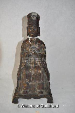 A Chinese cast iron figure of Taoist the immortal, traces of gilt paint, 23cm.