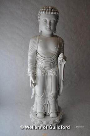 A large blanc-de-chine figure of a standing god, 44cm.