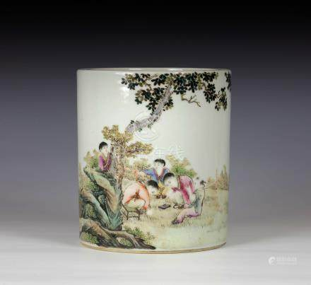 A Chinese porcelain famille rose brush pot, probably early 20th century, of cylindrical form with