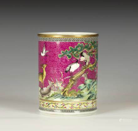 A Chinese famille rose verte pink ground brush pot, bears blue enamelled four character Qianlong