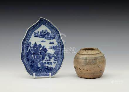 A Chinese blue and white porcelain leaf shaped dish, Qianlong period, painted with a lake scene with