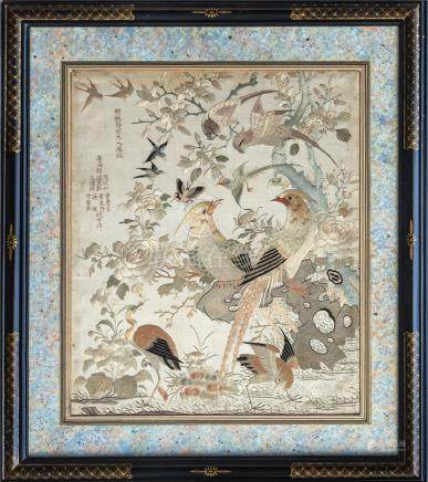 An early 20th century Chinese embroidery on silk, depicting birds and butterflies amidst a flowering