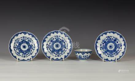 A set of three Chinese porcelain blue and white saucers, probably Kangxi period, painted with a