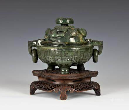 A Chinese finely carved spinach-green jade tripod censer and cover, Qianlong style, the censer in