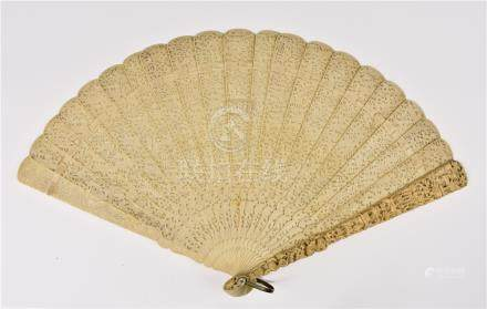A Chinese Canton carved ivory fan, 19th century, the flared guards carved with flowers below figures