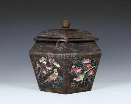 A Chinese black lacquered and mother of pearl hexagonal box and cover, 19th century, the angled