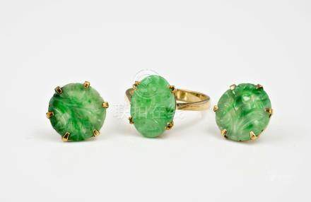 A pair of 9ct gold and Chinese carved jade stud earrings, the circular mottled apple green and