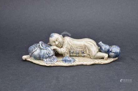 Celadon Glazed with Underglaze Blue Sleeping Child