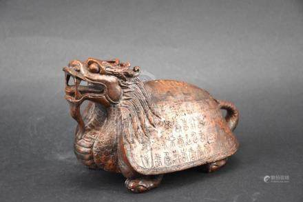 Old and very heavy hard stone carving of a dragon
