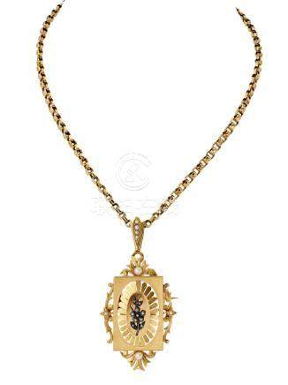 PENDENTIF-BROCHE en médaillon d'or jaune,